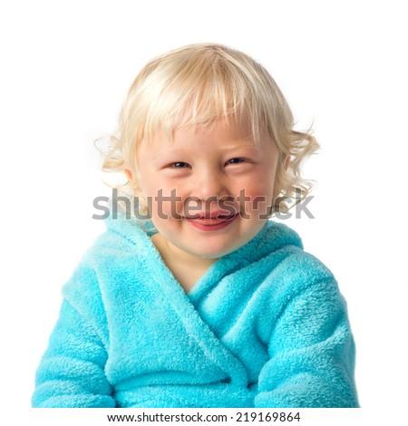 Happy little boy with bathrobe - stock photo
