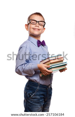 Happy little boy with books isolated on white background - stock photo