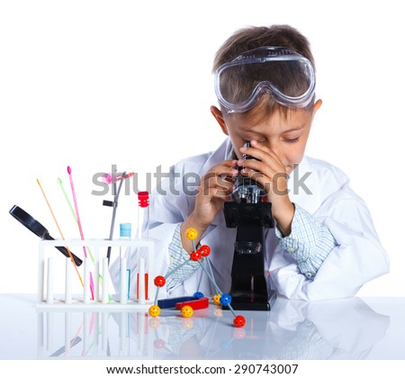 Happy little boy with flasks for chemistry and microscope. Isolated on a white background