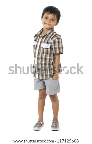 Happy little boy with hands in pockets on white background - stock photo