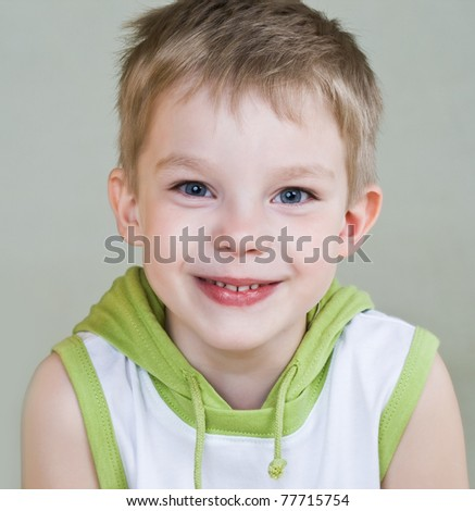 Happy little boy with smile - stock photo