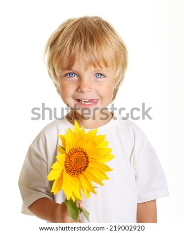 Happy little boy with sunflower isolated on white background - stock photo