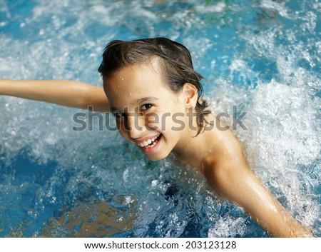 Teen Boy Enjoying Swimming Pool Stock Photo - Image of