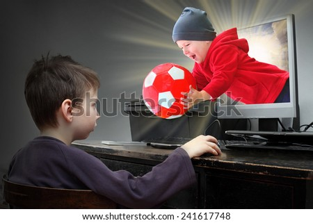 Happy little boys playing online pc game. Virtual reality concept.  - stock photo