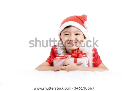 Happy little boys with gift on white background.