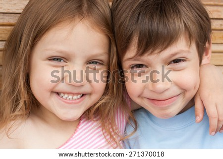 happy little brother and sister - stock photo