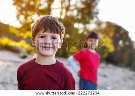 Happy little brothers outdoor, out of focus background, outdoor portrait - stock photo