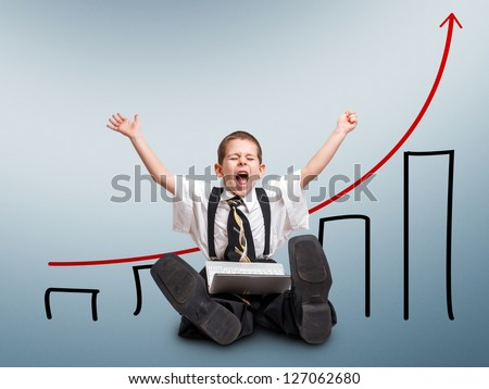 Happy little business man with laptop and scheme profits - stock photo
