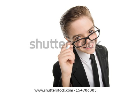 Happy little businessman. Cheerful little boy in formalwear adjusting his glasses and smiling while isolated on white