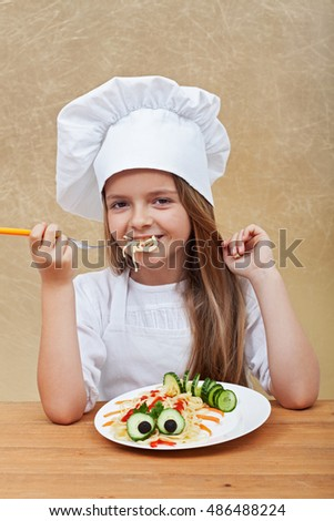 Happy little chef eating a pasta dish - creative food