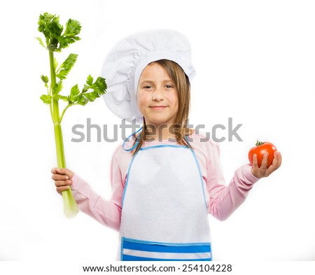 Happy little chef holding vegetables  - stock photo