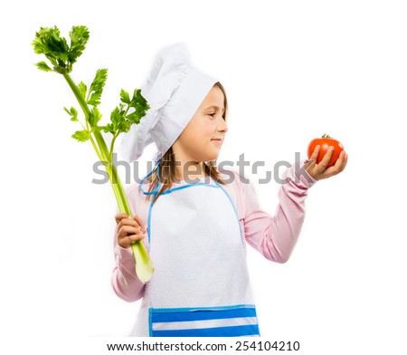 Happy little chef holding vegetables isolated on white background - stock photo