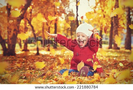 happy little child, baby girl laughing and playing in the autumn on the nature walk outdoors - stock photo