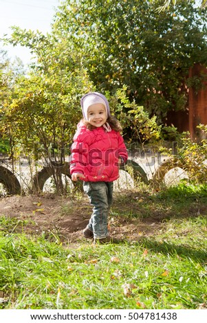 happy little child, baby girl playing in the autumn on the nature walk outdoors.
