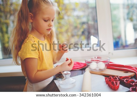 Happy little child baking Christmas cookies at home - stock photo