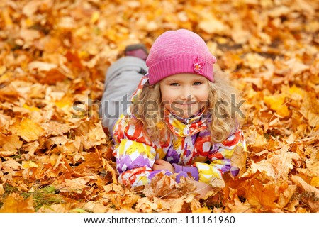 Happy little child in autumn park