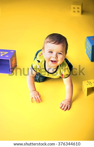 Happy little child playing - stock photo