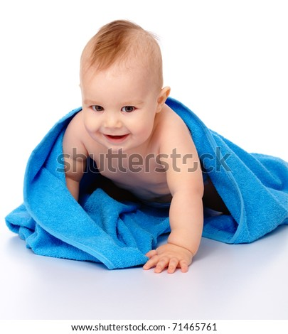 Happy little child wrapped in blue towel, isolated over white