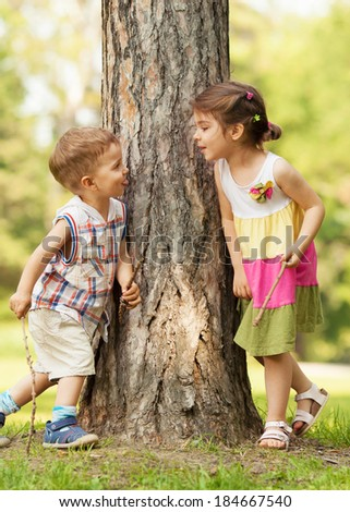Happy little children playing in the park. - stock photo
