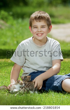 Happy little children with little cats outdoor playing - stock photo