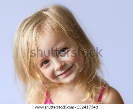 happy little girl a on gray background - stock photo