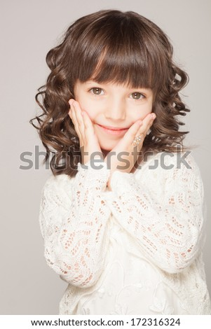 happy little girl a on white background - stock photo