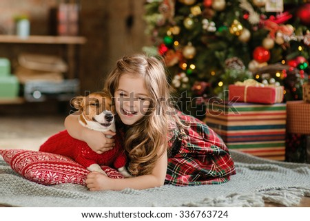 Happy Little girl and dog at Christmas - stock photo
