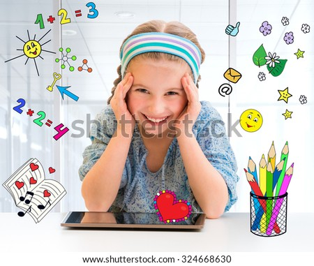 Happy little girl and her magic tablet - stock photo
