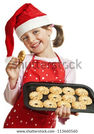 happy little girl baking Christmas cookies - white background - stock photo