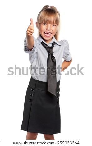 Happy little girl. Cheerful little girl showing her thumbs up, isolated on white background. - stock photo