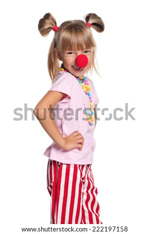 Happy little girl. Cheerful little girl with clown nose, isolated on white background. - stock photo