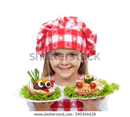Happy little girl chef with creative sandwiches - isolated - stock photo