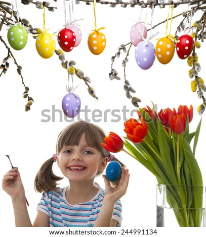 happy little girl coloring easter eggs - stock photo