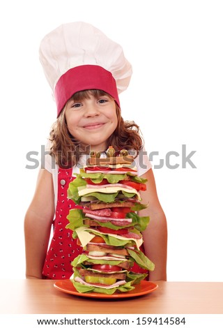 happy little girl cook and tall sandwich