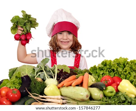 happy little girl cook holding radish vegetables