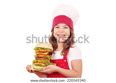 happy little girl cook with big hamburger - stock photo