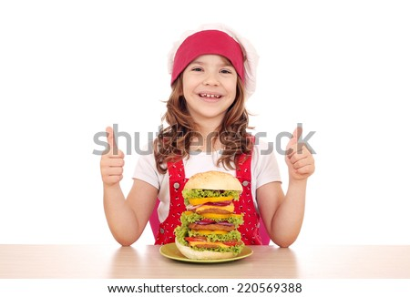 happy little girl cook with big hamburger and thumbs up - stock photo