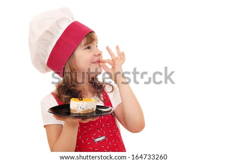 happy little girl cook with cake and ok hand sign - stock photo