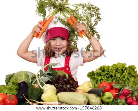 happy little girl cook with carrots and vegetables - stock photo