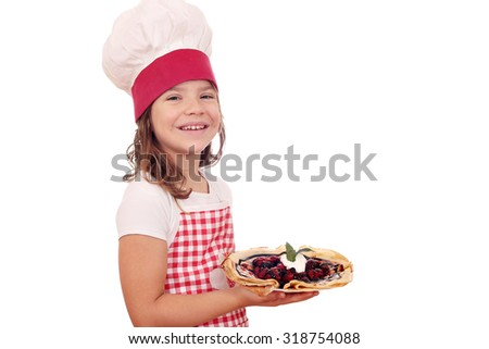 happy little girl cook with crepes dessert - stock photo