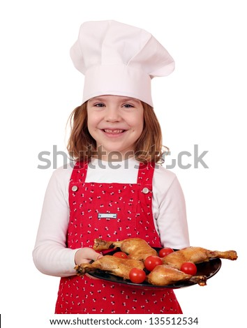 happy little girl cook with delicious chicken drumsticks