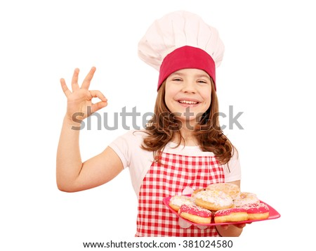 happy little girl cook with donuts and ok hand sign - stock photo