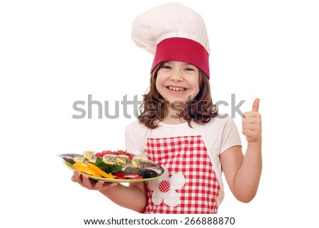 happy little girl cook with prepared trout and thumb up - stock photo