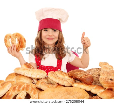 happy little girl cook with pretzel and thumb up - stock photo