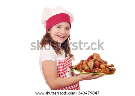 happy little girl cook with roasted chicken drumsticks