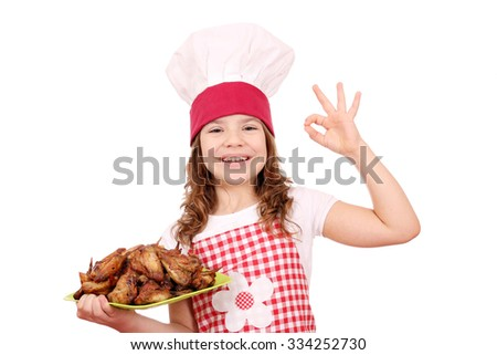 happy little girl cook with roasted chicken wings and ok hand sign - stock photo