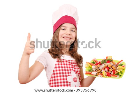 happy little girl cook with seafood and thumb up