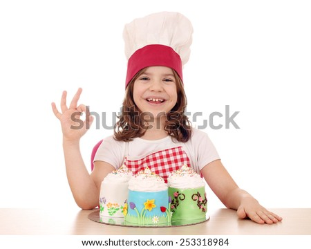 happy little girl cook with sweet cakes and ok hand sign - stock photo