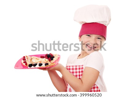 happy little girl cook with sweet crepes - stock photo