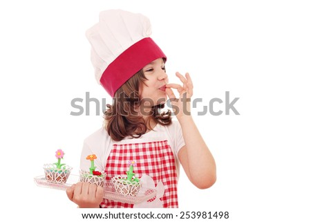 happy little girl cook with sweet muffin - stock photo